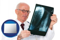 wyoming a radiologist looking at an x-ray image