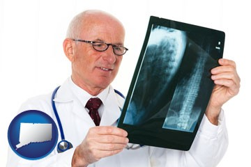 a radiologist looking at an x-ray image - with Connecticut icon