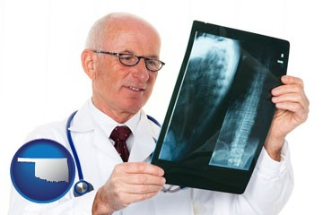 a radiologist looking at an x-ray image - with Oklahoma icon